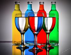 I like this image because of the mixture of different coloured bottles and the effect the glasses have when they are put in front of them.