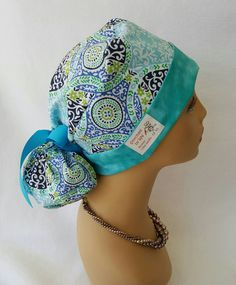 Check out this item in my Etsy shop https://www.etsy.com/listing/454554526/ponytail-scrub-hat-with-ribbon-scrub-hat
