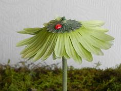 Fairy Garden Flower Umbrella miniature accessories green with lady bug by TheLittleHedgerow on Etsy https://www.etsy.com/listing/183007056/fairy-garden-flower-umbrella-miniature