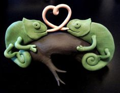 chameleon cake topper. the girl chameleon would have to be pink like Anja, and the other one would be Titus-colored.