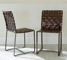 Thomas leather side chairs..pottery b arn