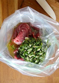 Carne Asada- 6 cloves garlic, minced 1 large handful fresh cilantro leaves, minced Juice of 3 limes and 1 orange or 2 lemons 1/2 cup olive oil, 1 tsp. cumin,1 tsp. salt A few turns of freshly cracked black pepper 1 1/2-2 lbs. flank steak
