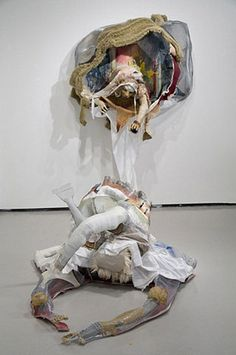 """""""El Juego del Tra Tra"""" by Daphne Arthur: Daphne combines painting, sculpture, drawing, and collage, as well as unexpected materials, in her work in an effort to break down archetypal aesthetic barriers while at the same time knocking down stereotypical perceptions on issues of race, gender, religion, and cultural identity."""