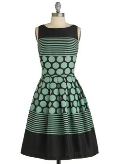 Cool effect on a simple structured dress.  You could piece this with complimenting fabric designs.