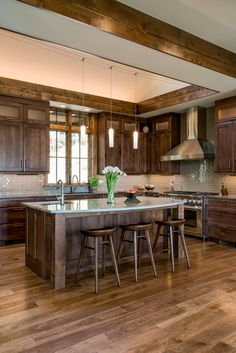 Wood floors, dark cabinets, stained cabinets, kitchen island, wood beams
