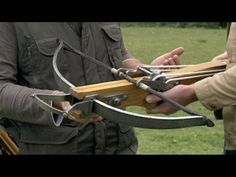 Heavy weight winch operated medieval crossbow in action.