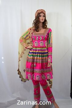 Mursal Formal Afghan Dress.  Absolutely gorgeous, Pink Afghan dress decorated with beautiful stitching on the skirt, sleeves, and scarf. Comes with a unique and colorful embroidery. Includes an equally beautiful embroidered head scarf and pants. The length is long, and the fabric is smooth like satin; it's made from formal charmeuse material. Wear this luxurious, unique Afghan dress to a party, wedding, or special occasion and you will definitely stand out from the crowd.