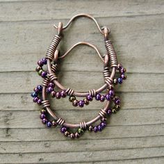 Ruffle Bottom Hoops - wire wrapped antiqued copper cuties in purple iris mix.by BearRunOriginals, via Etsy.