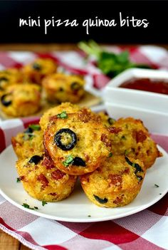 Mini Pizza Quinoa Bites-----2 cups cooked quinoa, cooled  2 whole eggs 2 egg whites  2 cups chopped pizza toppings 1 cup shredded mozzarella cheese  1/4 grated parmesan cheese  1 teaspoon Italian seasoning  Pizza sauce Oven to 350 degrees, spray a 24-cup mini muffin tin VERY well with nonstick spray.Mix all ingredients except pizza sauce. Fill mini muffin tin cups place on prepared baking sheet and bake for 15-20 minutes, or until golden brown.. Serve with pizza sauce.