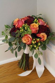 Orange and red bouquet..roses, mini calla lily, hypericum berries, seeded euc
