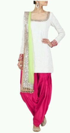 Ivory and red chikankari short kurta set. It comes with a pink silk salwaar and neon green net dupatta. FABRIC: Chikan and net. CARE INSTRUCTIONS: Dry Clean only