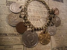 Hey, I found this really awesome Etsy listing at https://www.etsy.com/listing/175636905/world-coins-75-inch-bracelet-ooak