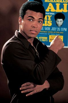 Ali poses with the fight poster for his upcoming fight against Jimmy Ellis during a photo shoot in J. - Neil Leifer for Sports Illustrated Mohamed Ali, Sports Illustrated, Combat Boxe, Float Like A Butterfly, Boxing Champions, Ali Quotes, Kentucky, Sports Memes, Sports Stars