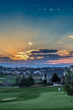 The Colorado sunset over hole 18 at Heritage Eagle Bend Golf Club