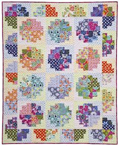 """this pattern """"Sweet Rolls""""  : quilt made using the Offset Log Cabin block : one 2-1/2″ wide jelly roll & one 1-1/2″ wide honey bun set"""