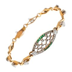 Edwardian Diamond Emerald Platinum/Yellow Gold Bracelet | From a unique collection of vintage link bracelets at https://www.1stdibs.com/jewelry/bracelets/link-bracelets/