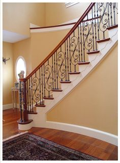 This is it...wrought iron pattern, cherry wood floors, paint color, white trim.