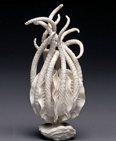This sculpture was made by Linday Feuer. The tentacles remind me of some kind of sea creature reaching up. I really like how she tangled them up with one another, giving the piece a complicated look. The inside of the piece is pretty remarkable with the fine detail and uniform waves. 9/24 Pin 1