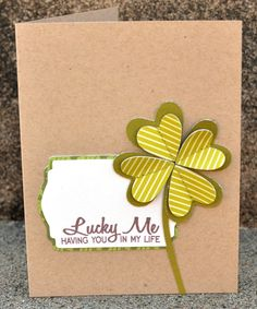 clean and simple card with layered cricut  cut flowers. Lucky Me stamp from you're so punny set.