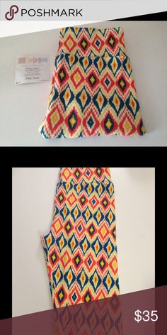 LuLaRoe Diamond Pattern Leggings NWT Great For Summer! Diamond Pattern With Blue, Pink, Yellow and White. NWT. Thoroughly Checked For Defects and They Are In Perfect Condition. Never Worn Or Tried On. **Price Is Firm Unless Bundled** LuLaRoe Pants Leggings