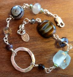 custom order bracelet with various stones, crystals, recycled glass and handmade silver link. Kiwi Jane.