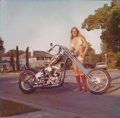Vintage Picture of a Girl Next to a Stars and Stripes Chopper    View EXCLUSIVE Images on Our Pinterest Page- Follow Us - http://pinterest.com/lcralliesinfo/    Ride safe,      JB      LightningCustoms.com Motorcycle Rallies Site    http://www.lightningcustoms.com/rally.html