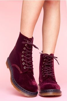 Red velvet lace-up boots.