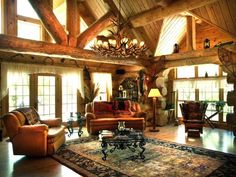 With lots of windows all around and massive beams throughout (even in the bathrooms), the architecture of this splendid home will appeal to anyone who wants something special. Cabin Homes, Log Homes, Timber Homes, Small Living Rooms, Living Room Decor, Living Roon, Family Rooms, Log Cabins For Sale, Modern Architecture Design