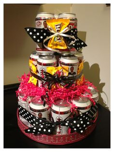 """Soda can birthday cake. Previous Pinner  """"I made for my coworker... She loves diet dr pepper and M&Ms... I used 24 cans, and use large rubber bands to hold the cans together, and dowels to help stabilize the layers.. Accented with ribbon and candy... Easy and cheap birthday gift"""""""