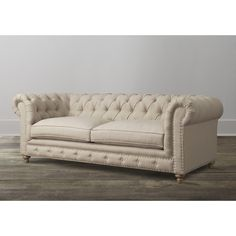 Furniture. Beige Leather Tufted Chesterfield Sofa With Brown Wooden Legs On Shabby Chic Harwood Floor With Leather Recliners And Leather Sectional Sofa. Luxurious Tufted Chesterfield Sofa For Living Room Decor Ideas