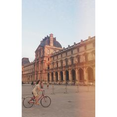 Just creeping on a stranger at the #Louvre because she makes this pic look old fashion & awesome with her dress and bike. #Paris