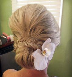 Wedding hairstyle with a flower.