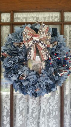 Front door wreath made with a straw wreath and old jeans.