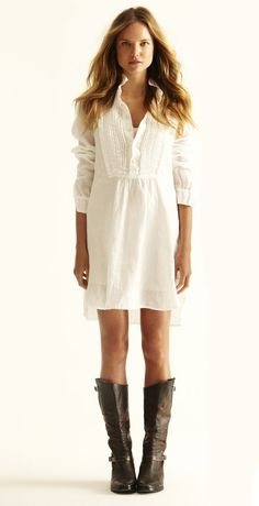 A white cotton dress with tall riding boots looks good!