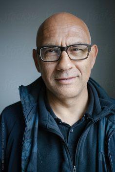 Portrait of a happy bald man with glasses by Koen Meershoek #stocksy #realstock