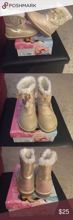 Gold Zip Up Disney Princess Boots Toddler Sz 9 Used Disney boots in Toddler Sz 9 by Stride Rite. Still in good condition. Side zipper allows easy entry. Beautiful gold shimmer with gold sequin and faux tied up lace. Stride Rite Shoes Boots
