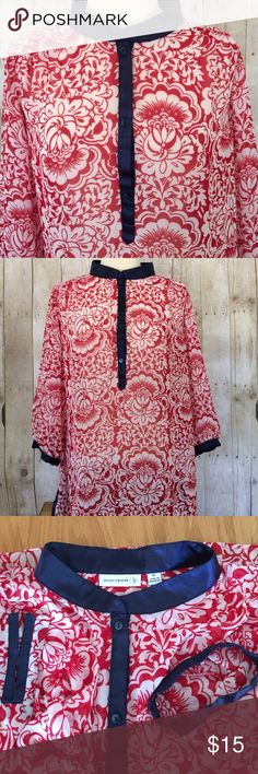 "Susan Graver Top Beautiful Susan Graver top! Sheer fabric in red and white with navy blue banding on cuffs , side splits, neck and front placket. 3 button front. 100% polyester. 24"" across from side to side. 3/4 length sleeves. About 29"" long from top of neck to hem (center back).  Back yoke with slight gathering. Excellent used condition. Please ask any questions and check out bundling to save! Susan Graver Tops Blouses"