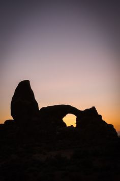 Sunset at Turret Arch in Arches National Park, Utah.