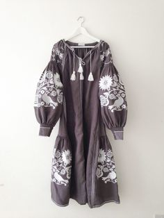 Beautiful hand made folk dress, embroidered with our exclusive bird print. Midi length, can be worn loose or belted (Belt included) Made with the...