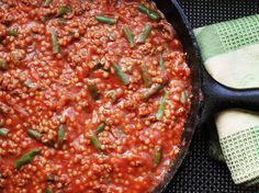 Skillet Ground Lamb with Tomato Sauce, Green Beans, and Couscous Recipe Main Dishes with olive oil, onion, ground black pepper, kosher salt, ground lamb, ground turmeric, ground cumin, cayenne pepper, peel tomato whole, green beans, water, couscous, lime, juice