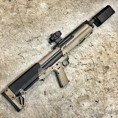 Kel-Tec KSG 12-gauge with Aimpoint red dot and suppressor