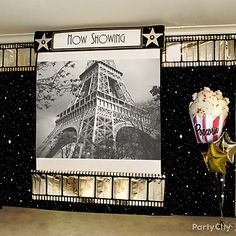 Create a dramatic backdrop for a movie party ... Click to see how to get this look, and see more star-studded Hollywood party ideas!
