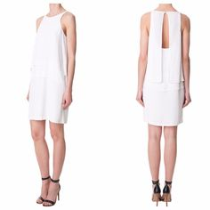 Tibi Silk Halter Dress BRAND NEW- Size 2 Tibi Silk Halter Dress- BRAND NEW WITH TAGS GREAT FOR A REHEARSAL DINNER! Or holiday party!  This lightweight silk crepe de chine dress is a proven easy dress for day or evening. This sleeveless piece has an open back and layered overlay detail. Single button closure at back neck and hidden zip closure at skirt back. Fully lined. Fabrication: 100% Silk CDC. Dry Clean Only.  Size 2 . Trades Tibi Dresses Midi