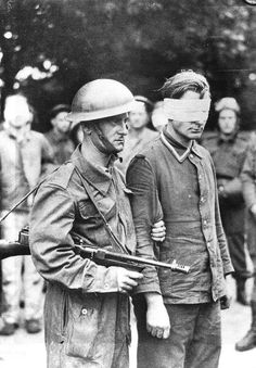 82c8d969190 Canadian soldier armed with Thompson submachine gun guides German prisoner  captured during Operation Jubilee (Library