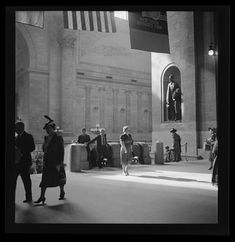 Interior of Penn Station, 1939. [I think that stature can be found behind the canopy these days]