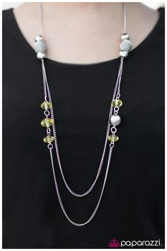 Translucent yellow gems combine with sleek silver beads for a refined display. Infused with layer of simple silver chain, chunky silver beads featuring a spun rope texture crown the design for a pinch of sparkling texture.    Sold as one individual necklace. Includes one pair of matching earrings.