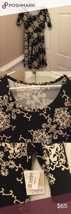 LulaRoe Nicole Elegant Collection Dress LulaRoe Nicole dress from the elegant collection. New with tags. Black with cream and gold pattern. Beautiful, I just have not had an occasion to wear it. LuLaRoe Dresses