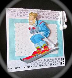 """Skier Dude Blue Decoupage Sheet on Craftsuprint designed by Gordon Fraser - made by Cynthia Massey - Printed onto 200gm card, cut out and mounted onto white embossed/blue spotty/8 x 8"""" white card with snow cut border top and bottom which I cut on my cameo, decoupaged with foam pads, just tied furry white wool and pom poms round the top, if ordered this can be personalised with a name/greeting. - Now available for download!"""