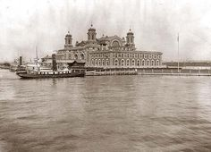 View of Ellis Island, N.Y., looking across water toward immigration station.  It was made in 1913