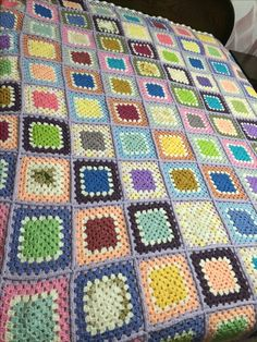 Granny square blanket, I like the joining & joining color used.  Four rounds color 1, one round white, two rounds color 2.  Very retro scrapghan looking to me.